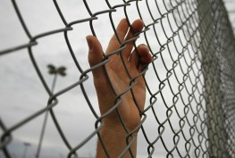 hand-on-chain-link-fence_main_2